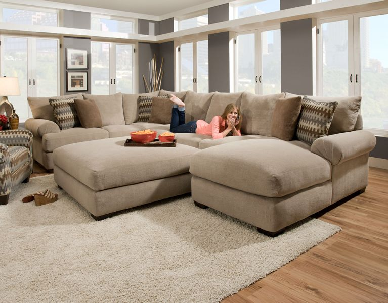 Massive sectional featuring an extra deep seat with crowned .